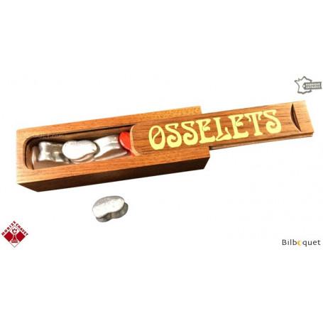 Osselets en métal en coffret en bois